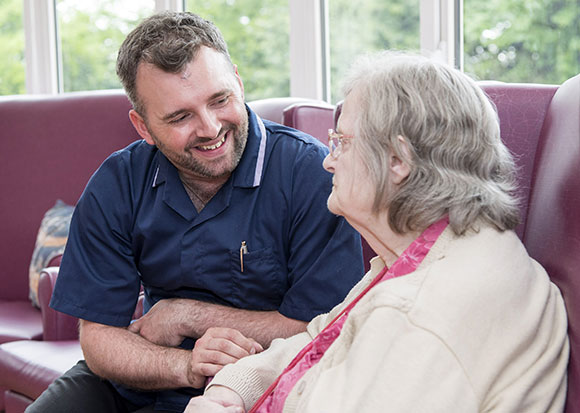Our Approach - Adam Talking to a Care Home Resident