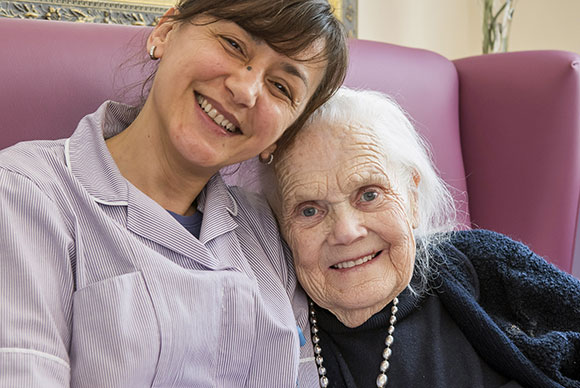 Broadland View Carer and Resident in the Lounge