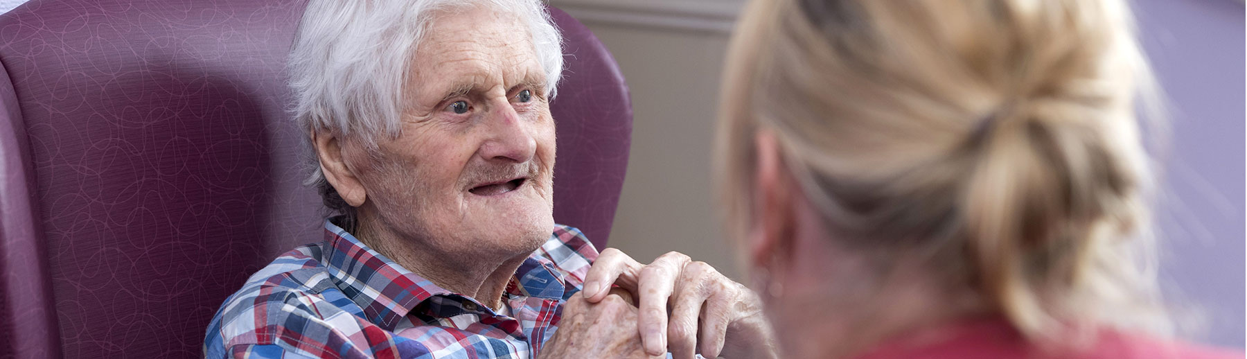 care-home-patient-talking-to-carer