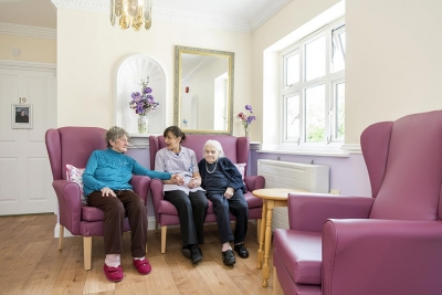 Small lounge carer talking with residents